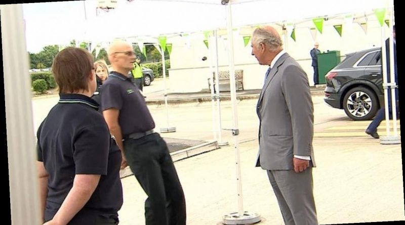 Moment stunned Prince Charles watches as Asda employee FAINTS during visit to Distribution centre to thank workers